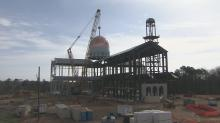 Construction crews raise dome of new Catholic cathedral in Raleigh