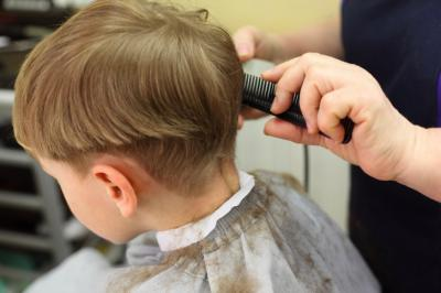 A little boy in England admired his neighbor's haircut so much, he begged his obliging uncle to give him a matching 'do. The only problem — the neighbor with the killer hair doesn't actually have much of it, at least not on top. (Deseret Photo)