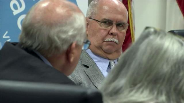 Wake County School Superintendent Jim Merrill, center, listens to school board member Bill Fletcher, left, during a May 31, 2016, budget discussion.