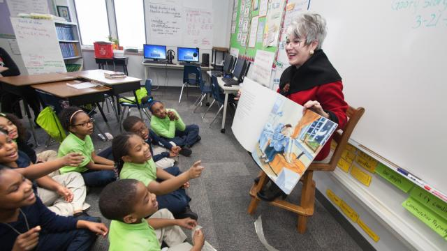 Dale-Elizabeth Pehrsson, bibliotherapist and head of Central Michigan University's Bibliotherapy Project, reads to students. (Deseret Photo)