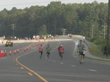 Winners cross finish at Race for the Cure