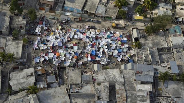 Haitians set up impromptu tent cities thorough the capital after an earthquake measuring 7-plus on the Richter scale rocked Port au Prince on Jan. 12, 2009. (Deseret Photo)