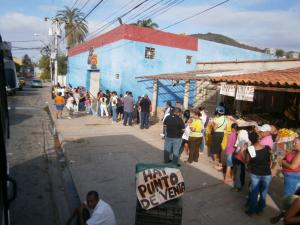 Venezuelans wait in line for food rations in Mercal. (Deseret Photo)