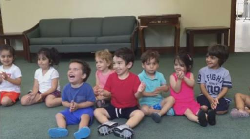 This toddler is having the best time in music class, and his best time is 100 percent contagious. (Deseret Photo)