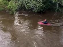 Guy try to canoeing through flooded river