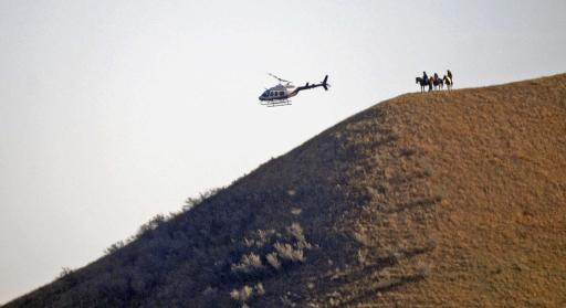 Three people on horseback watch from a hillside as a helicopter sweeps by on Wednesday, Oct. 26, 2016, near the New Camp on Pipeline Easement in southern Morton County, ND.The prospect of a police raid on an encampment protesting the Dakota Access pipeline faded as night fell Wednesday, with law enforcement making no immediate move after protesters rejected their request to withdraw from private land. Activists fear the nearly 1,200-mile pipeline could harm cultural sites and drinking water for the Standing Rock Sioux tribe. (Tom Stromme/The Bismarck Tribune via AP) (Deseret Photo)