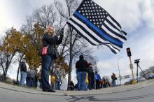 Darcy Peterson, of Bismarck, stands alone while holding a Thin Blue Line flag in support of law enforcement during a small rally supporting the Dakota Access Pipeline protesters on Saturday, Oct. 19, 2016, near the state Capitol in Bismarck, N.D. The protesters, living in camps in rural Morton County, N.D., near the pipeline construction have clashed with law enforcement with hundreds of arrests made by authorities. (Mike McCleary  /The Bismarck Tribune via AP) (Deseret Photo)