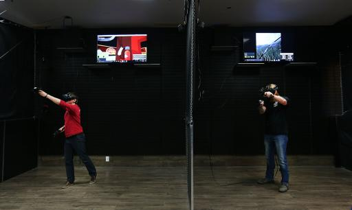 Jonathan Krone of Dallas and Charles Fowler of Salt Lake City play virtual reality games at VR Junkies at the Valley Fair Mall in West Valley on Friday, Feb. 3, 2017. (Deseret Photo)