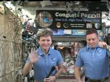 Astronaut marks record on International Space Station
