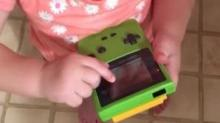 IMAGE: Have You Seen This? Girl is baffled by touch screen-less Game Boy