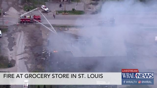Fire burns at St  Louis grocery store :: WRAL com