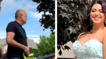 IMAGE: This Adorable Dad Used A Genius Trick To Help His Daughter Get The Perfect Prom Photos
