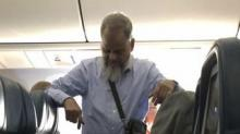 IMAGE: This Man Apparently Stood For 6 Hours On A Flight So His Wife Could Sleep