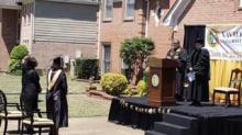 IMAGE: This Dad Built A Stage In His Driveway To Throw His Daughter A Graduation Ceremony