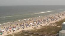 IMAGES: Memorial Day draws crowds to beaches, heats up debates about social distancing