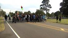 IMAGES: Protesters gather at site where Roxboro man killed by officer; state of emergency, curfew still in effect