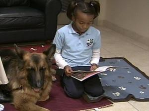 Rudy listens to children read at Durham's Emily K Center.