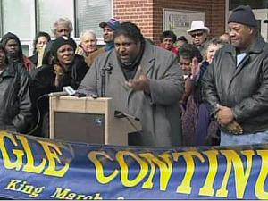 Rev. William Barber, president of the state chapter of the NAACP, was among protesters speaking out Thursday against the Chapel HIll-Carrboro City Schools' recent decision to add more honors courses to the high school curriculum.