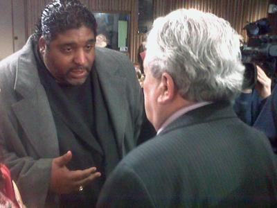 State NAACP President Rev. William Barber speaks to Wake County Board of Education Chairman Ron Margiotta during a break at the Tuesday, March 2, 2010, school board meeting. Barber opposes the board majority's stance on changing the student assignment policy, which buses students to achieve economic diversity.