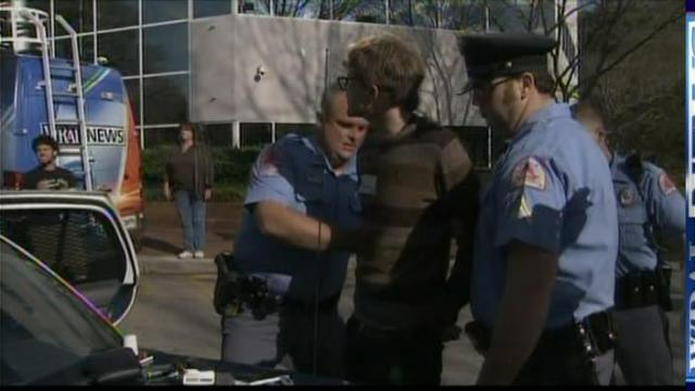 Dante Emmanuel Strobino, 29, of Raleigh, is arrested on Tuesday, March 23, 2010, outside the Wake County Board of Education's headquarters during a protest of the board's pending vote in favor of a resolution to begin moving away from the school system's policy of busing students to achieve socio-economic diversity.