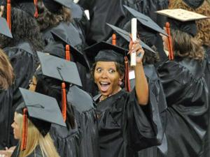 New graduates smile and celebrate at Campbell University's commencement ceremony on Saturday, May 15, 2010. (Photo courtesy of Scarborough Photography)