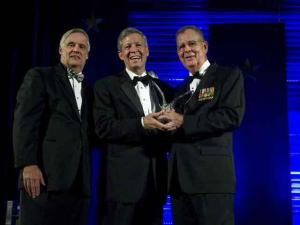 Under Secretary of Defense and Chief Financial Officer Robert Hale (left) and Assistant Secretary of Defense for Reserve Affairs Dennis McCarthy (right) presented the 2010 Secretary of Defense Employer Support Freedom Award to Dr. Steven Ballard, chancellor of East Carolina University (center). The Freedom Award, presented Sept. 23 in Washington, D.C., is the highest recognition given by the U.S. government to employers for their outstanding support of employees who serve in the National Guard and Reserve. (Photo courtesy of Susan Davis International)