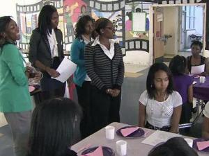 Volunteers from Shaw participate in the after-school program Ladies of Distinction held each week at Ligon GT Magnet Middle School.