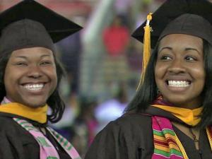 Seniors smile as they graduate from Shaw University on Saturday, May 7, 2011.