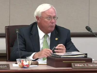 "State School Board Chairman Bill Harrison speaks out against the proposed state budget during a meeting June 2, 2011. ""I think this budget is a disgrace,"" he said."