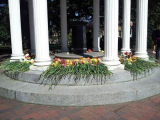 """People left flowers at the Old Well on the UNC-Chapel Hill campus on Oct. 12, 2012, in honor of the death of former UNC President William C. """"Bill"""" Friday."""