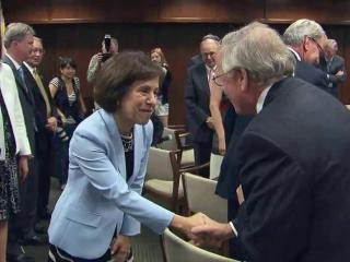 Members of the UNC Board of Governors congratulate Carol Folt on April 12, 2013, after she is named chancellor of UNC-Chapel Hill.