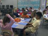 Cooper signs class size fix into law