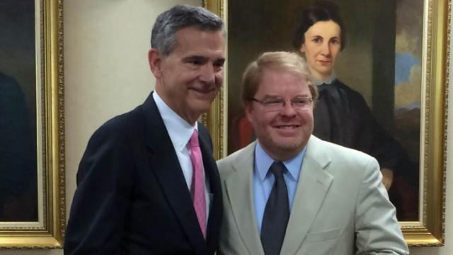 Incoming UNC Board of Governors Chairman John Fennebresque, left, poses with outgoing Chairman Peter Hans on June 20, 2014, shortly after the board elected Fennebresque to a two-year term.