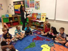 Kindergarten teacher Daly Romero Espinal teaches her students basic Spanish commands on the first day of school at Martin Millennium Academy. Credit Reema Khrais