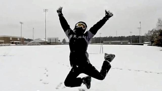 South Johnston High School guidance counselor Tabitha Ward dances in the snow on Feb. 24, 2015.
