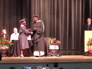 De'Nique Pickering accepts her diploma.