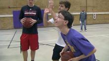 IMAGE: Special students, 'Pack players hoop it up at Broughton