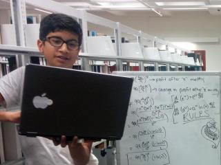 Andy Kamath (left) and Neeraj Gandhi (right) do calculations modeling revenue growth during the Summer Ventures program at North Carolina State University in summer 2015. (Photo courtesy of Andy Kamath)