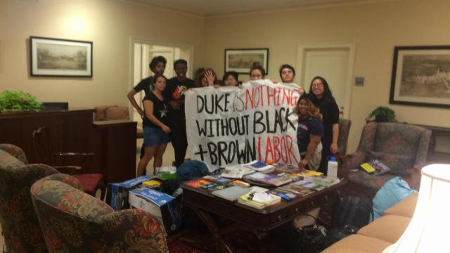 Duke students protesting the treatment of a parking attendant by a campus executive took their argument to his office Friday afternoon.