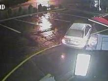 Surveillance photos showing a silver or gray sedan many help police solve the shooting death of a man found in a car Thursday night on Raleigh's Capital Boulevard.