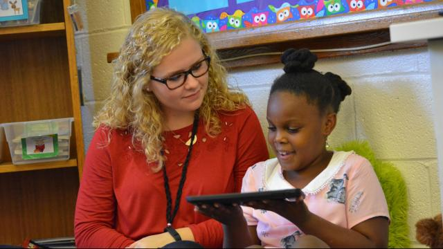 Paige Christianson, a junior education major at N.C. State University, works with a student at Conn Magnet Elementary School on Oct. 12, 2016.