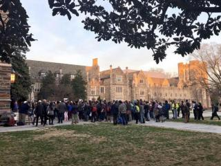 Dozens of Duke University students rally on Jan. 31, 2017, to protest President Dona;d Trump's halt to immigration from majority-Muslim countries. (Photo by Sarah Krueger)