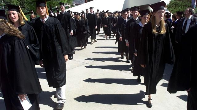 BYU graduates march to the Marriott Center for graduation ceremony. (Deseret Photo)