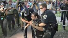At least two arrested as protesters march through Chapel Hill