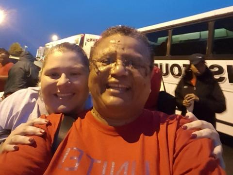 "Educator Erline Lyde takes a ""selfie"" in Charlotte, where she and many other teachers woke up early on Wednesday to catch a bus to Raleigh."
