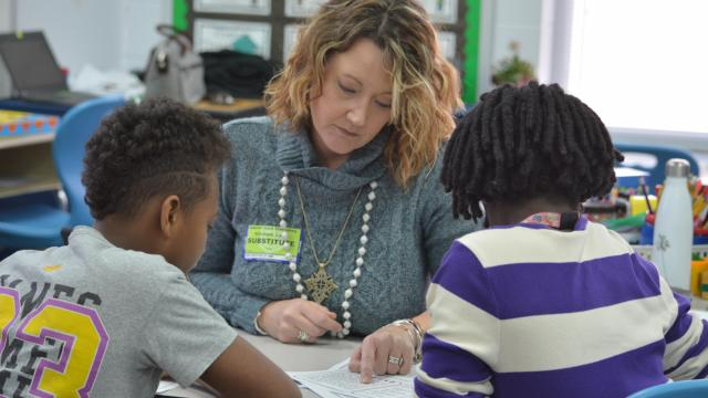 Laura Kilcrease works as a substitute teacher at Abbotts Creek Elementary School in Raleigh on March 1, 2019.