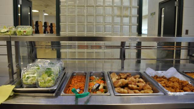 Lunch items await students in a buffet line at Neal Middle School in Durham (Julia Donheiser/WRAL contributor).