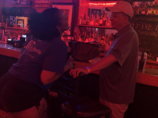 Photos surfaced of East Carolina University Interim Chancellor Dan Gerlach, in hat, at a Greenville bar frequented by students.