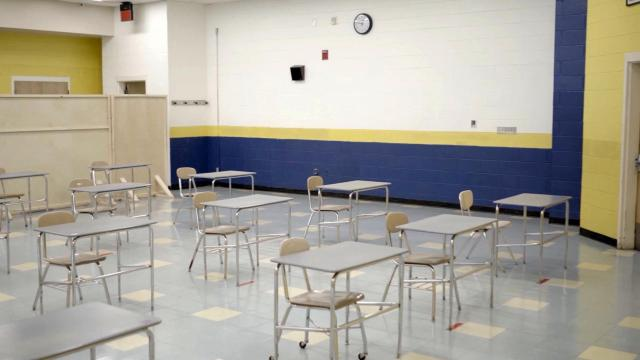 At East Hoke Middle School, the cafeteria has been divided into temporary classrooms with desks spaced six feet apart.