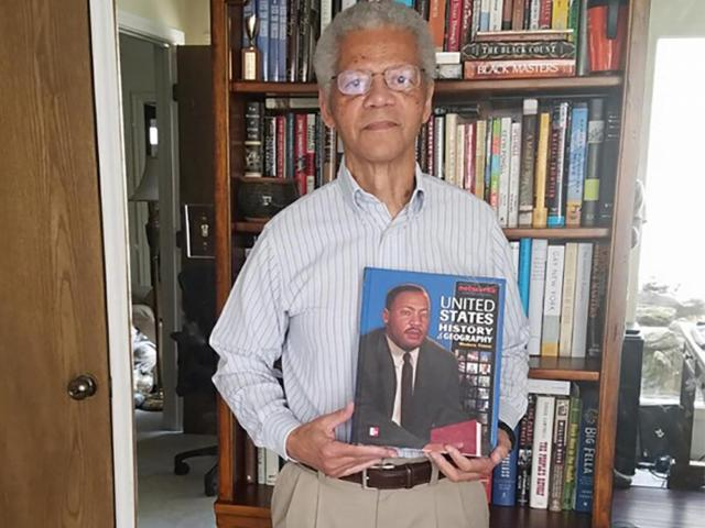 Albert Broussard pictured here in his home in Texas. He is one of the most prolific textbook writers in the US.